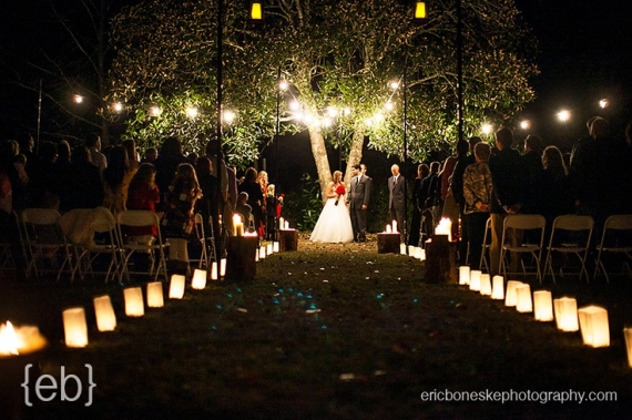 use luminaries and battery operated candles to line the aisle at a night wedding ceremony