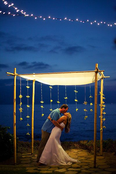 oceanfront view with glowing arbor - night wedding ideas