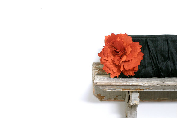 orange and black clutch purse via 30 Amazing Halloween Wedding Ideas from EmmalineBride.com