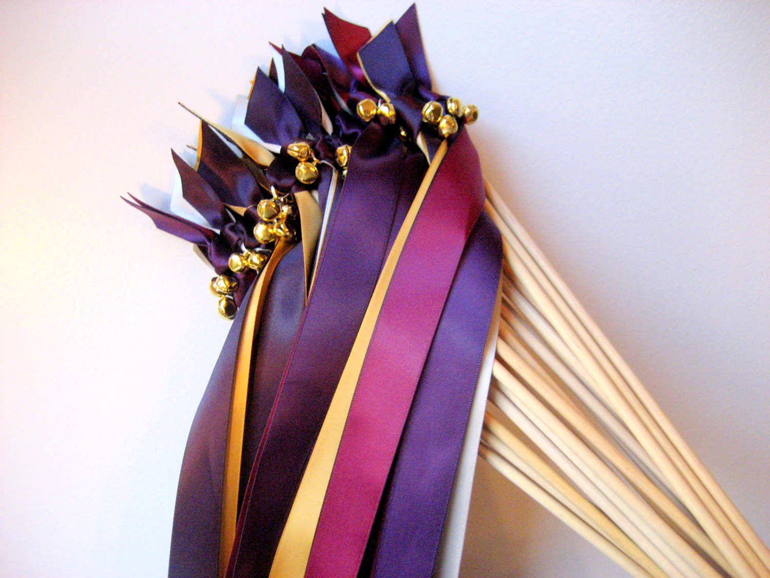 pink and purple ribbon wands with bells