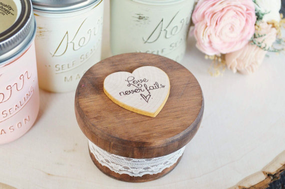 ring box round with love never fails on top