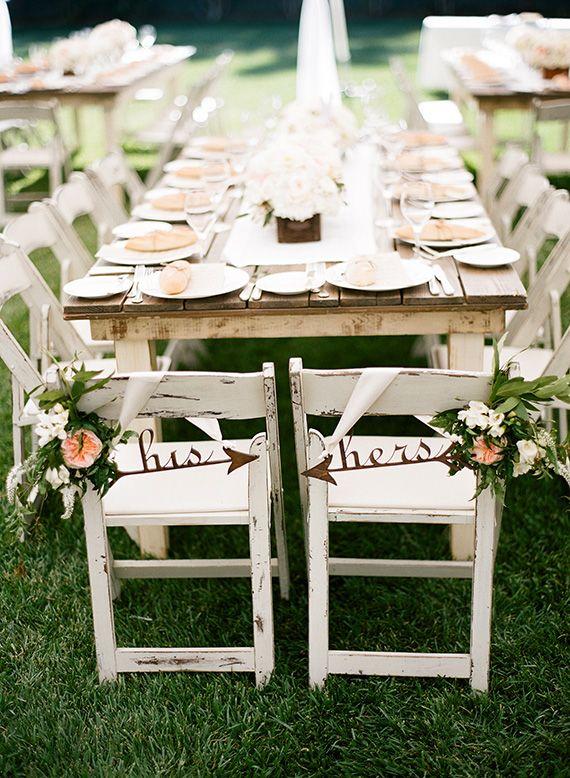 his and hers arrow chair signs via 20+ Boho Arrow Wedding Ideas