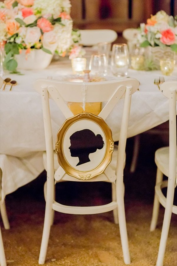 Silhouette chair signs can be used to reserve seats for the bride and groom.  These silhouette signs feature a stunning gold frame which adds an elegant touch. Photo by Olivia Smartt, signs by Crafted By Kerstin.