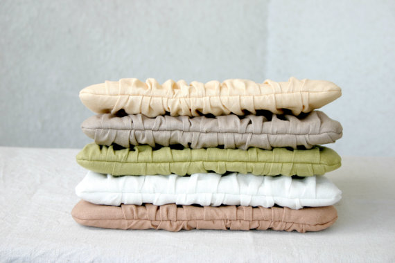 stack of pleated clutch purses