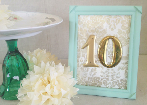 Gold Table Numbers with Light Blue Frame (by River Kiss Weddings via Emmaline Bride)