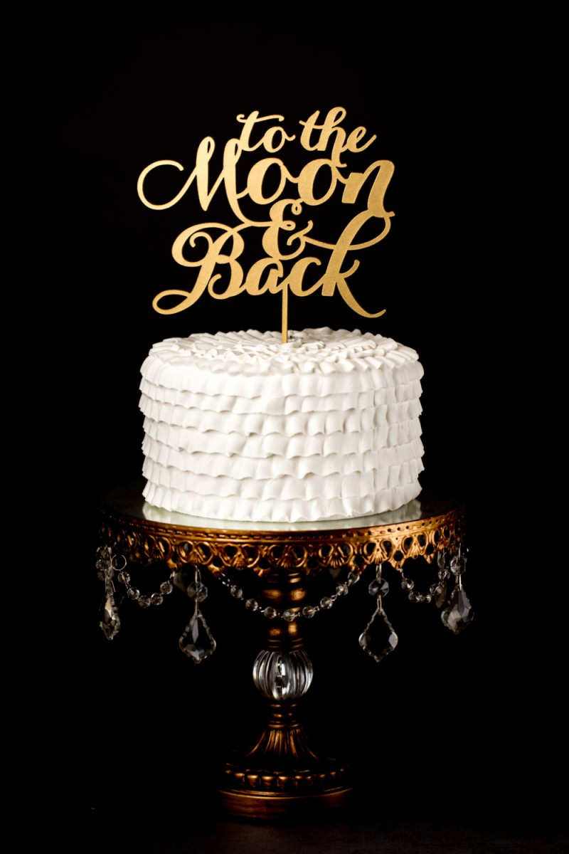 to the moon and back | cake toppers via http://emmalinebride.com/decor/statement-cake-toppers/