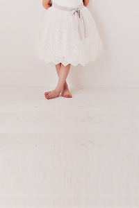 up close of flower girl dress with lace to show scallop lace detail