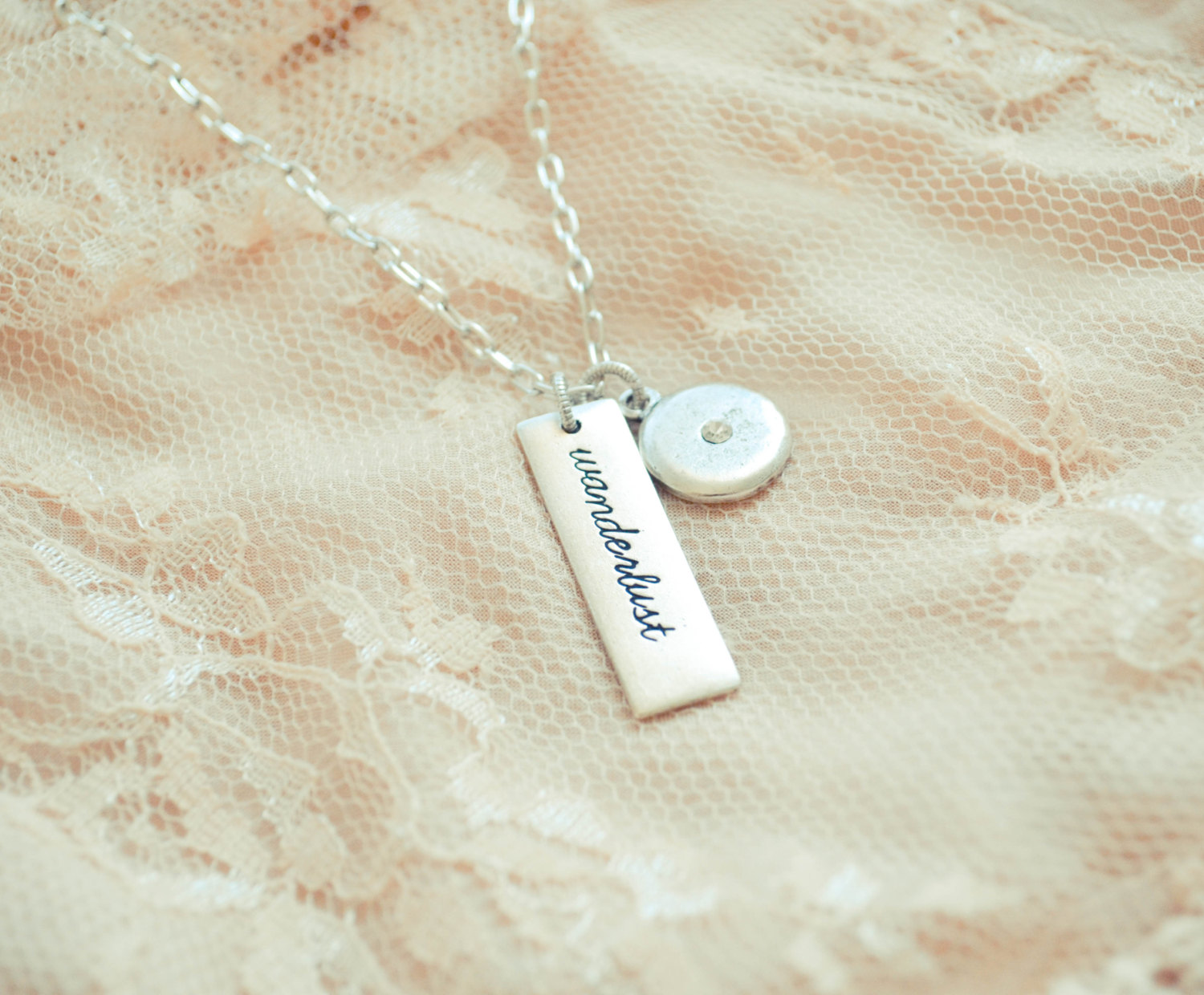 wanderlust necklace with heart | gifts bridesmaids travel | http://emmalinebride.com/gifts/gifts-bridesmaids-travel