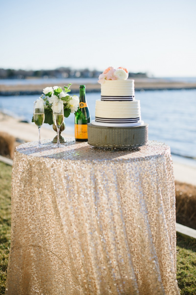 wedding cake with navy blue and white striped ribbon, photo: natalie franke | via http://emmalinebride.com/decor/navy-and-white-wedding-ideas/ | from 21 Navy and White Wedding Ideas