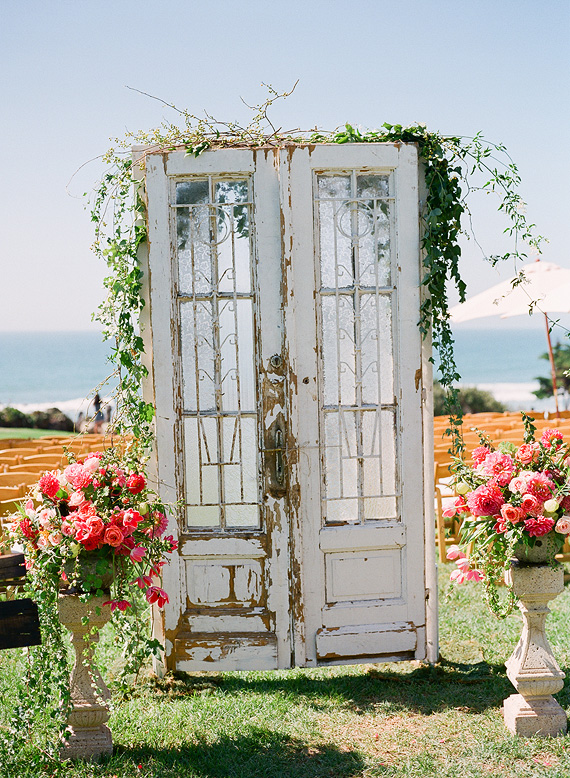 wedding ceremony backdrop with doors outdoor wedding | Ceremony Backdrops Doors | photo: John Schnack