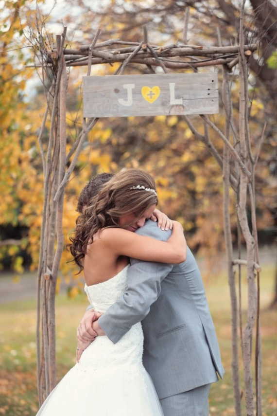 Decorate your ceremony arch with a custom wood sign featuring your wedding initials hand-painted on.