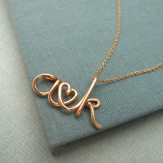 Your wedding initials can be worn around your neck thanks to these pretty script letters.