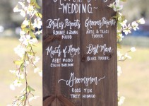 wedding program sign by the paper walrus