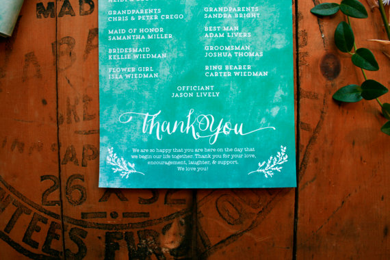 bottom of blue wedding programs with thank you