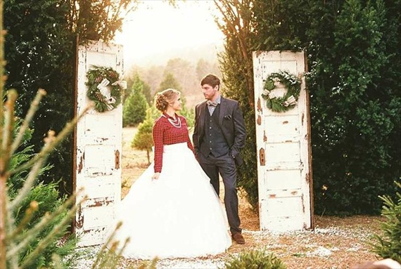Winter Ceremony Backdrop Idea Using WreathsCeremony Backdrops Doors | photo: Photo Vision